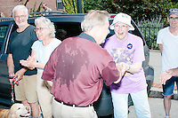 Republican presidential candidate Lindsey Graham greets people as he marches in the Labor Day parade in Milford, New Hampshire.  Republican candidates John Kasich, Carly Fiorina, and Democratic candidate Bernie Sanders also marched in the parade.