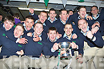 The Milltown/Castlemaine players celebrate on stage at their home coming in Milltown on Monday night front row l-r: Seamus O'Dwyer, Marcus Mangan, Shane Murphy, John O'Connor, Jerome Flynn. Back row: Jamie O'Shea, Cieran McKenna, Brendan Delaney, Kevin McKenna, Mark Ring, Paul Carroll and Mike Burke ..