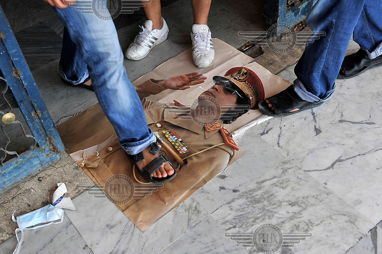 A picture of Gaddafi serves as a doormat in front of the central hospital in Tripoli. After a six month revolution, rebel forces finally managed to break into Tripoli and have taken control of Bab al-Aziziyah, Col Gaddafi's compound and residence. Few remain that are loyal to Gaddafi in the city; it is seeming that the 42 year regime has come to an end. Gaddafi is currently on the run.