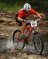 NWA Democrat-Gazette/ANDY SHUPE<br /> Geoffrey Maples of Siloam Springs, a rider with Cross Country Cyclery, crosses Lee Creek Saturday, Sept. 19, 2015, while competing in the Northwest Arkansas Mountain Bike Championships at Devil's Den State park. Visit nwadg.com/photos to see more photographs from the race.