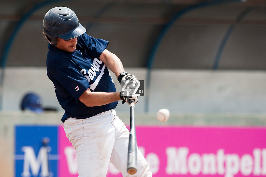 23 May 2009: Romain Martinez-Scott of Savigny makes contact during the 2009 challenge de France, a tournament with the best French baseball teams - all eight elite league clubs - to determine a spot in the European Cup next year, at Montpellier, France. Savigny wins 4-1 over Senart.