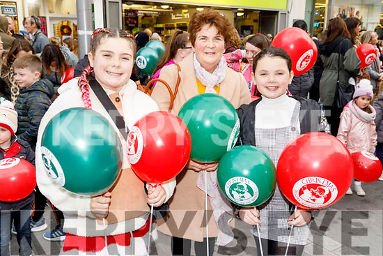 Chloe O'Brien, Margaret Ryan and Britney Coffey from Tralee enjoying the CH Chemist's Santa Parade on Saturday