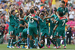 Mexico's players celebrate winning the gold medal against Brazil after the match at Wembley Stadium, London, UK. Saturday 11th August 2012. (Photo: Steve Christo)