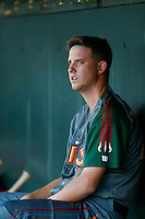 Paul Blackburn #34 of the Boise Hawks sits in the dugout after pitching one inning in a rehab start against the Eugene Emeralds at PK Park on July 25, 2013 in Eugene, Oregon. Eugene defeated Boise, 5-4. (Larry Goren/Four Seam Images)