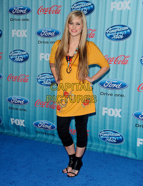 "MEGAN CORKREY .at The ""American Idol"" Top 13 Party.at Area in Hollywood, California, USA, March 5th 2009                                                                     .full length mustard yellow dress tunic black leggings ankle booties shoe boots sandals open toe hands on hips rose print .CAP/DVS.©Debbie VanStory/RockinExposures/Capital Pictures"