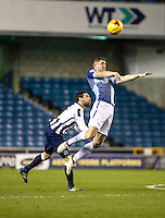 Dan Rowe of Wycombe Wanderers and David Worrall of Millwall during the Checkatrade Trophy round two Southern Section match between Millwall and Wycombe Wanderers at The Den, London, England on the 7th December 2016. Photo by Liam McAvoy.