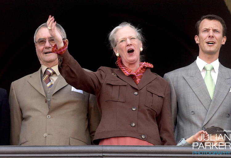 Prince Henrik, Prince Joachim & Prince Nikolai appear on the balcony of The Amalienborg Palace in Copenhagen to celebrate The Queen of Denmark's 64th birthday..