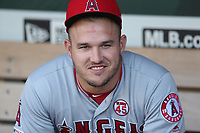 OAKLAND, CA - SEPTEMBER 4:  Mike Trout #27 of the Los Angeles Angels sits in the dugout before the game against the Oakland Athletics at the Oakland Coliseum on Wednesday, September 4, 2019 in Oakland, California. (Photo by Brad Mangin)
