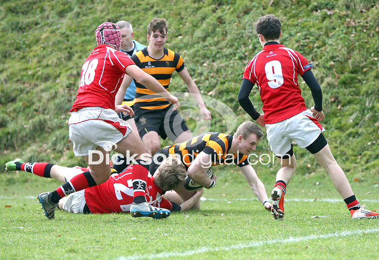 SCHOOLS CUP 2015  | Saturday 7th February 2015<br /> <br /> Ben McGavock is tackled short of the line during the third round of the 2015 Ulster Schools Cup between RBAI and Regent House at Osborne Park, Belfast.<br /> <br /> Picture credit: John Dickson / DICKSONDIGITAL