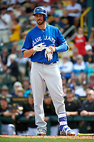 Toronto Blue Jays first baseman Chris Colabello (15) takes his batting gloves off at home during a Spring Training game against the Pittsburgh Pirates on March 3, 2016 at McKechnie Field in Bradenton, Florida.  Toronto defeated Pittsburgh 10-8.  (Mike Janes/Four Seam Images)