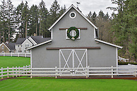 Barn and house with Christmas wreath. Near Wilsonville. Oregon