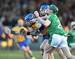 Shane O Donnell of  Clare  in action against Sean Finn and Richie Mc Carthy of  Limerick during their NHL quarter final at the Gaelic Grounds. Photograph by John Kelly.
