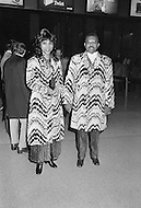 Manhattan, New York City, NY - January 28, 1974  <br /> Muhammad Ali and Joe Frazier at Madison Square Garden  - Billed as the &lsquo;Fight of the Century&rsquo; African-American boxing fans and dandies attended wearing the most glam-fashions of the day. Furs, minis and thigh-high platform boots were all the rage.
