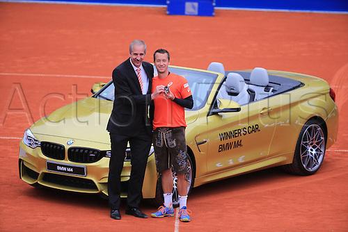 01.05.2016. Munich, Germany. BMW Open 2016 MTTC Iphit Munich singles final.  Winner Philipp Kohlschreiber (GER) with his trophy and prize winners BMW car. Kohlschreiber beat Dominic Thiem (aut) in 3 sets.