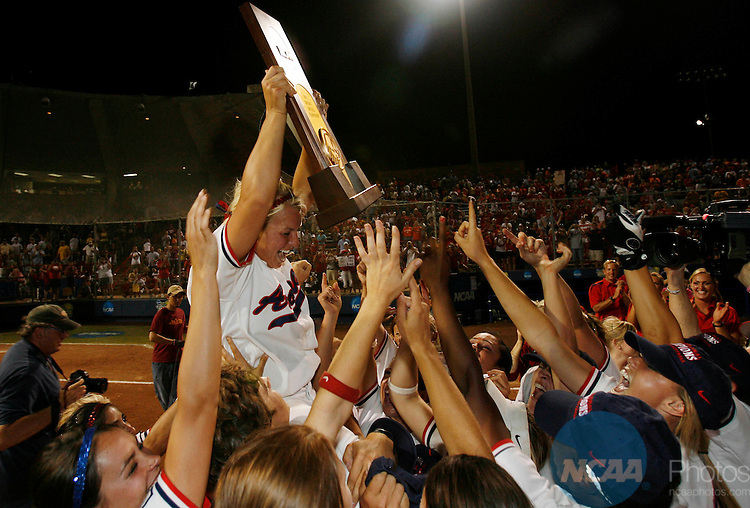 06 JUN 2007: Teammates hold up Arizona pitcher Taryne Mowatt (9) after defeating Tennessee during the Division l Women's Softball Championship held at ASA Hall of Fame Stadium in Oklahoma City, OK. Stephen Pingry/ NCAA Photos