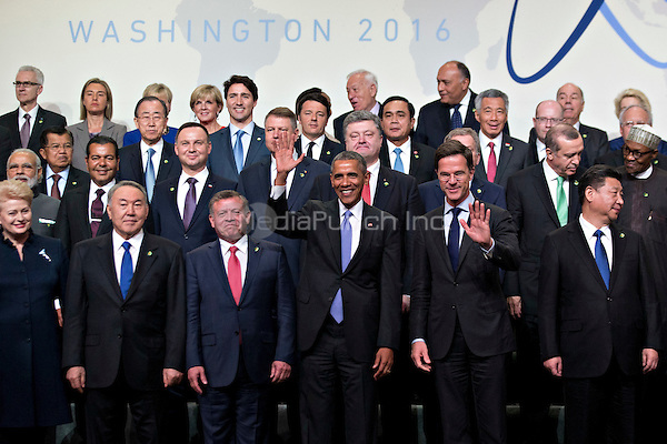 United States President Barack Obama, center, and Mark Rutte, Dutch prime minister, center right, wave among other heads of state including Xi Jinping, China's president, right, and attendees during a family photo at the Nuclear Security Summit in Washington, D.C., U.S., on Friday, April 1, 2016. After a spate of terrorist attacks from Europe to Africa, Obama is rallying international support during the summit for an effort to keep Islamic State and similar groups from obtaining nuclear material and other weapons of mass destruction. <br /> Credit: Andrew Harrer / Pool via CNP/MediaPunch
