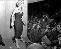 "Marilyn Monroe, motion picture actress, appearing with the USO Camp Show, ""Anything Goes,""  poses for the shutterbugs after a performance at the 3rd U.S. Inf. Div. area.  February 17, 1954.  Cpl. Welshman.  (Army)<br /> NARA FILE #  111-SC-452342<br /> WAR & CONFLICT BOOK #:  1466"
