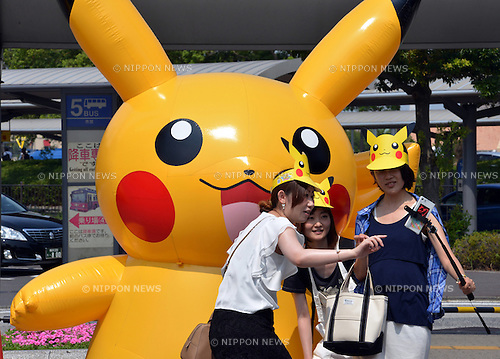 "August 10, 2016, Yokohama, Japan - People take souvenir photos with dozens of Pikachu balloons, Nintendo's videogame software Pokemon's wellknown character, at a station suare in Yokohama, suburban Tokyo on Wednesday, August 10, 2016. The Pikachu mascots walk around the shoppjng mall daily to attract summer vacationers as a part of the ""Great Pikachu Outbreak"" event through August 14.    (Photo by Yoshio Tsunoda/AFLO) LWX -ytd-"