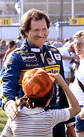 Dale Earnhardt talks with fans prior to the start of the Pepsi 400 at Daytona International Speedway in July 1986.(Photo by Brian Cleary)