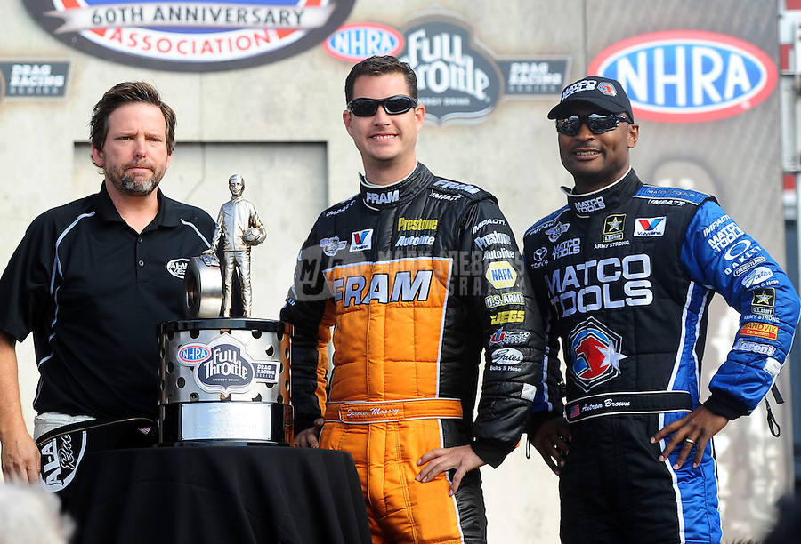 Nov. 13, 2011; Pomona, CA, USA; NHRA top fuel dragster drivers Del Worsham (left), Spencer Massey (center) and Antron Brown with the 2011 championship trophy during the Auto Club Finals at Auto Club Raceway at Pomona. Mandatory Credit: Mark J. Rebilas-.