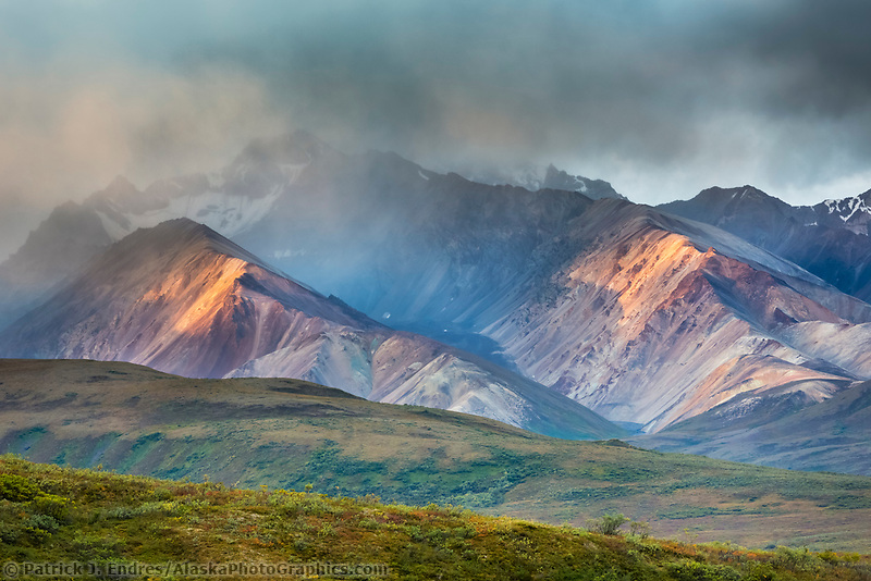 Morning light falls on the colorful mountain hillsides of Polychrome mountains in Denali National Park, Alaska.