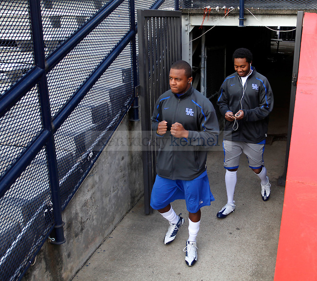 Sophomore wide receiver Randall Cobb and junior wide receiver Kyrus Lanxter walk onto Pat Day Field to start warming up at Jordan-Hare Stadium Saturday. The UK Wildcats face the Auburn Tigers at Jordan-Hare Stadium in Auburn, Ala. during Saturday's game. Photo by Zach Brake | Staff
