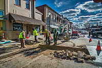 Workers inspect the trench cut into State Street for sewer repair.