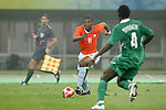 07 August 2008: Ryan Babel (NED) (11) looks to beat Onyekachi Apam (NGA) (4) toward goal.  The men's Olympic soccer team of the Netherlands played the men's Olympic soccer team of Nigeria at Tianjin Olympic Center Stadium in Tianjin, China in a Group B round-robin match in the Men's Olympic Football competition.