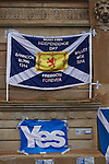 A flag and poster attached to a statue at a pro-independence gathering in George Square, Glasgow. The gathering brought together Yes Scotland supporters who favour Scotland leaving the union with the United Kingdom. On the 18th of September 2014, the people of Scotland voted in a referendum to decide whether the country's union with England should continue or Scotland should become an independent nation once again and leave the United Kingdom.