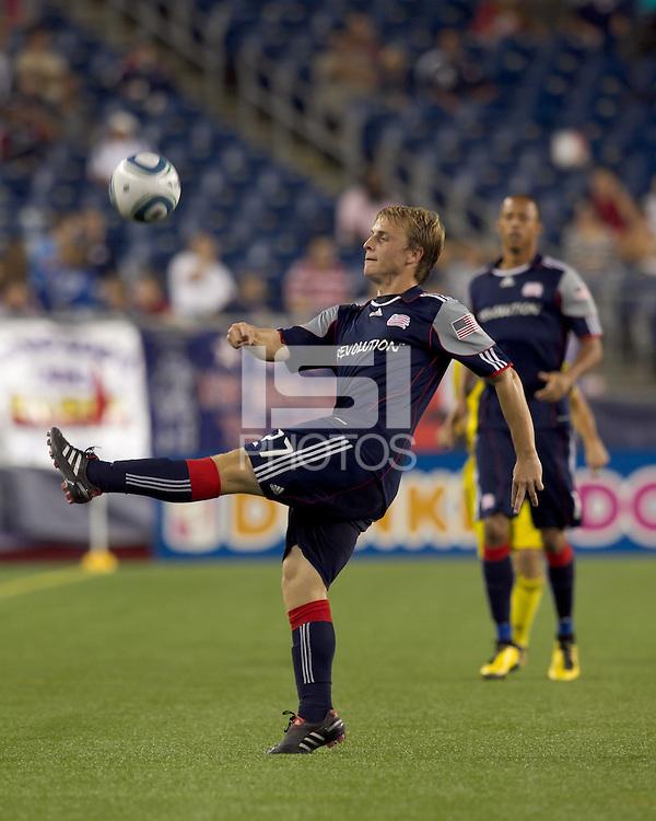 New England Revolution midfielder Seth Sinovic (27) vollies ball downfield. The New England Revolution tied Columbus Crew, 2-2, at Gillette Stadium on September 25, 2010.