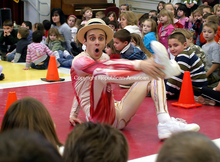 THOMASTON, CT. 23 JANUARY 05_NEW_020409DA03.jpg- Ethan Angelica, of the Bronx NY, portrays Mr. Slim Goodbody during a musical health show Wednesday at Black Rock School in Thomaston. The show teaches children about different parts of the human body.<br />  Darlene Douty