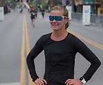 Half Marathon winner Elizabeth Lyles after crossing the finish line during the 6th Annual Reno 5000 Downtown River Run on Saturday, April 6, 2019.