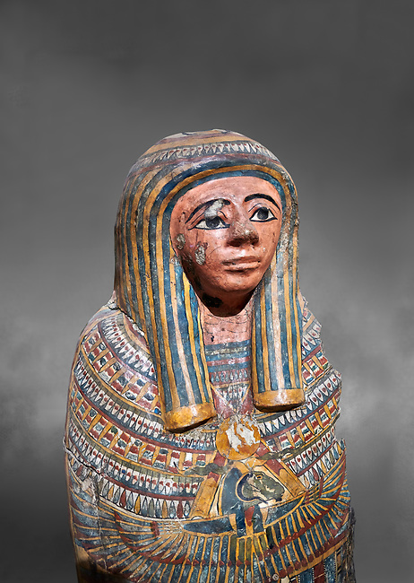 Ancient Egyptian Cartonnage funerary mask from the Third Intermediate Period, 22nd Dynasty (944-1025BC).  Egyptian Museum, Turin. Grey background<br /> <br /> Made from overlapping papyrus and cloth this cartonnage has been decorated with a weskh collar over which are depicted two crossed cloth strips that represent the last bandages of the deceased mummy wrappings. below this is depicted the rams head of god Amon-Ra against the out stretched wings of a vulture