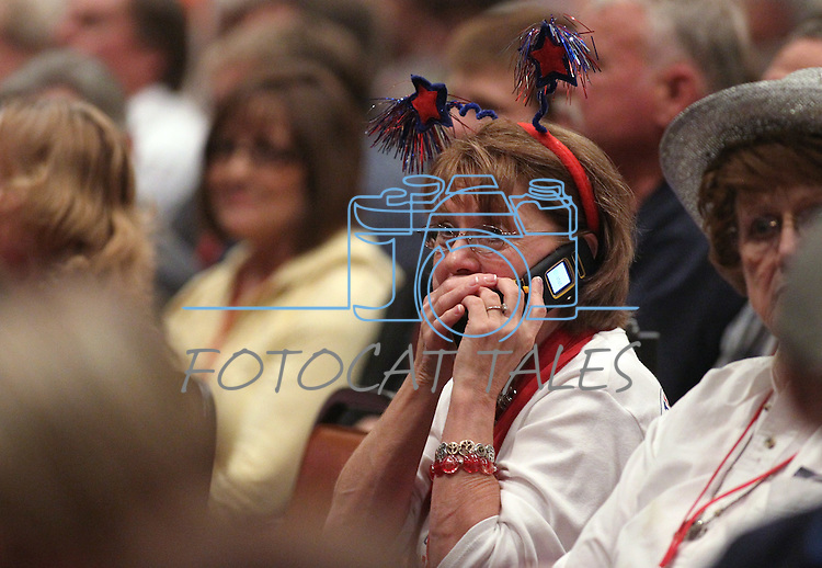 An unidenfied woman talks on a cell phone during a breain in the Nevada Republican Party Convention in Sparks, Nev., on Saturday, May 5, 2012..Photo by Cathleen Allison