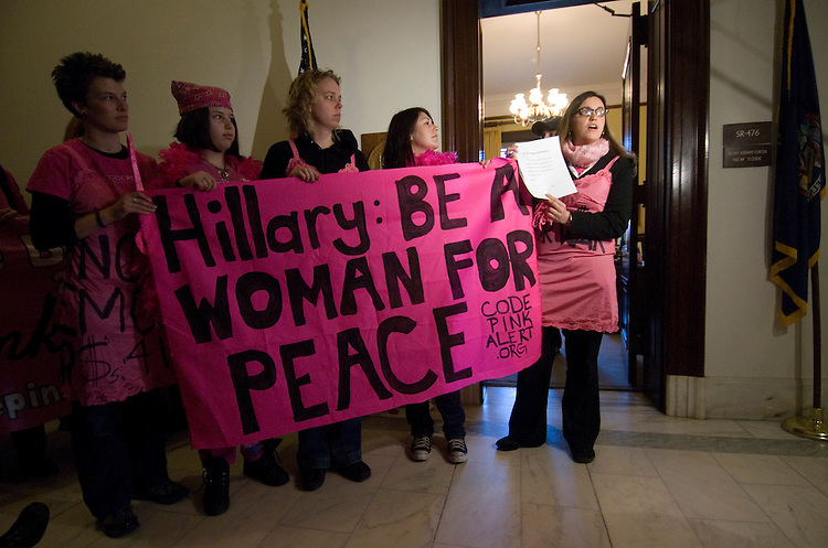 "Codepink members speak to the news media before creating a web of ribbons in Sen. Hillary Clinton's office in the Russell Building as they call on Clinton to ""dismantle her web of war"" on Tuesday, Jan. 30, 2007. Several of the Iraq war protesters were arrested in the hallway as police cleared the group out of the building."
