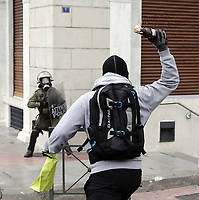 Pictured: A protester throws a petrol bomb to riot police officers Wednesday 17 May 2017<br /> Re: Clashes between anti fourth memorandum protesters and riot police during 24 hour strike in Athens, Greece