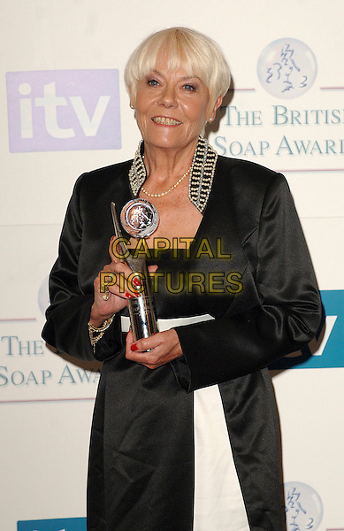 WENDY RICHARD.Inside the Press Room at the British Soap Awards 2007, BBC Television Centre, London, England. .May 26, 2007.half length wendi richards black white dress trophy award winner nail varnish polish pearl collar .CAP/BEL.©Belcher/Capital Pictures