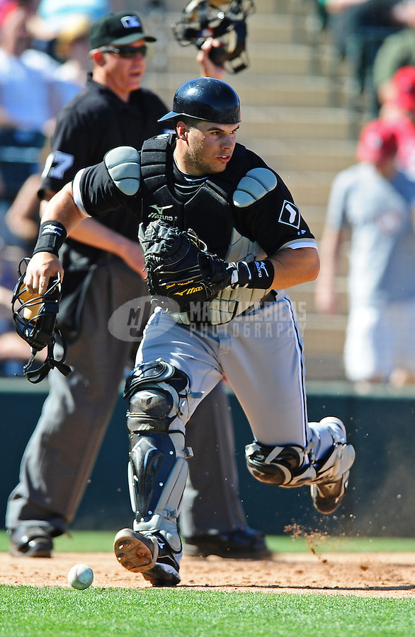 Mar. 6, 2012; Tempe, AZ, USA; Chicago White Sox catcher Josh Phegley fields a passed ball in the third inning against the Los Angeles Angels during a spring training game at Tempe Diablo Stadium.  Mandatory Credit: Mark J. Rebilas-