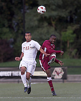 Boston College defender Stefan Carter (23) and Harvard University defender Baba Omosegbon (6) battle for the ball. Boston College defeated Harvard University, 2-0, at Newton Campus Field, October 11, 2011.