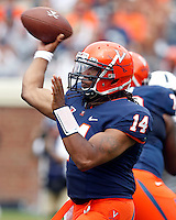 Virginia quarterback Phillip Sims (14) throws the ball during an NCAA college football game against Penn State in Charlottesville, Va. Virginia defeated Penn State 17-16.