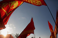 Communist party flags with pictures of Lenin and the hammer and sickle fly in the air during an approved demonstration of the Communist Party of Russia to rally for cheaper and free education, among other issues, in Moscow, Russia.
