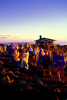 A group of people gather to watch a Haleakala sunrise