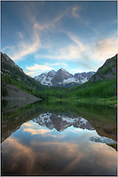 High clouds grace the Maroon Bells and Maroon Lake in this Colorado image. Evening was closing quickly, and all was quiet in this sanctuary of the Rocky Mountains.