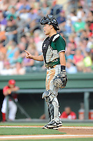 Catcher Eric Sim (11) of the Augusta GreenJackets signals to his teammates in a game against the Greenville Drive on Friday, July 11, 2014, at Fluor Field at the West End in Greenville, South Carolina. Greenville won, 7-6. (Tom Priddy/Four Seam Images)