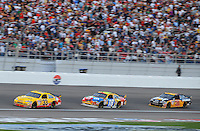 Mar. 1, 2009; Las Vegas, NV, USA; NASCAR Sprint Cup Series driver Clint Bowyer (33) leads Kyle Busch (18) and Jeff Burton (31) during the Shelby 427 at Las Vegas Motor Speedway. Mandatory Credit: Mark J. Rebilas-