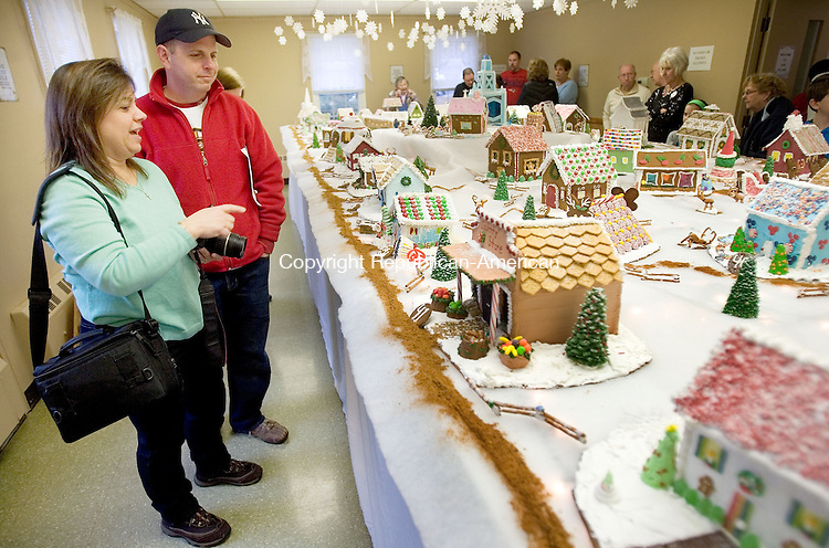 MIDDLEBURY CT. 05 December 2014-120614SV06-Sue and Ken Kliczewski of Newtown check out the Gingerbread Village during the annual Gingerbread Village and Christmas Bazaar at St. George's Episcopal Church in Middlebury Saturday.<br /> Steven Valenti Republican-American