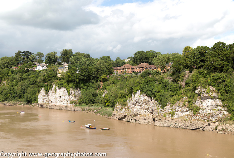 Cliff on River Wye from Chepstow, Monmouthshire, Wales, looking to Sedbury, Gloucestershire, England, UK