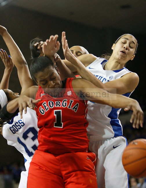 UK forward Samantha Drake and guard Bria Goss attempt a rebound against Georgia guard Khaalidah Miller during the second half of the women's basketball game vs. Georgia at Memorial Coliseum , in Lexington, Ky., on Sunday, February 03, 2013.  Photo by Genevieve Adams  | Staff.