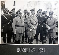 BNPS.co.uk (01202 558833)<br /> Pic: Jones&Jacob/BNPS<br /> <br /> Hitler at the Nurenberg rally in 1937.<br /> <br /> Springtime for Hitler...Chilling album of pictures taken by one of Hitlers bodyguards illustrates the Nazi dictators rise to power.<br /> <br /> An unseen album of photographs taken by a member of Hitlers own elite SS bodyguard division in the years leading up to the start of WW2.<br /> <br /> The 1st SS Panzer Division 'Leibstandarte SS Adolf Hitler' or LSSAH began as Adolf Hitler's personal bodyguard in the 1920's responsible for guarding the Führer's 'person, offices, and residences'.