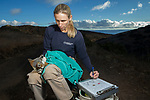 Santa Catalina Island Fox (Urocyon littoralis catalinae) biologist, Julie King, examining fox during vaccination and health check up, Santa Catalina Island, Channel Islands, California